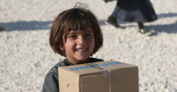 Syrian refugee children receive winter clothing and other gear from UNICEF with help from support from donors who purchase UNICEF Inspired Gifts.
