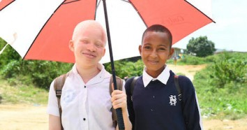 12-year-old girl from Côte d'Ivoire with albinism, with her friend.