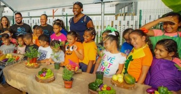 UNICEF USA Chief Engagement, Advocacy and Global Programs Officer Anucha Browne (center) and staff members from the Boys & Girls Clubs of Puerto Rico join children for a healthy eating celebration.