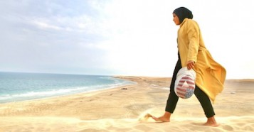 Ibtihaj Muhammad on the beach in Sealine, Qatar.