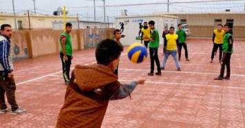 Omar (name changed), 14, serves at a volleyball game in Debaga camp in northern Iraq.