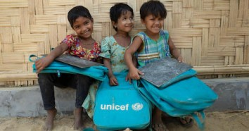 Rohingya girls sit outside a UNICEF-supported Learning Center in Balukhali camp for Rohingya refugees in Cox's Bazar District, Bangladesh in March 2018.