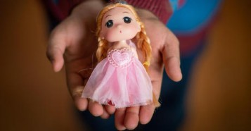 Yara, 10, still has her little doll from Syria in Za'atari Refugee Camp.