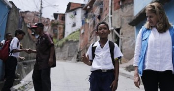 Nine-year-old student Wilker speaks with UNICEF Director of Communications Paloma Escudero in Petare, on the outskirts of Caracas, Venezuela in June 2019.