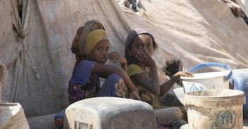 Children sit outside their tent at Al-Meshqafah camp for displaced persons in Lahj governate, southern Yemen, in February 2019.