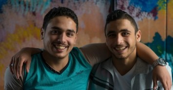 In 2016, Syrian refugees Watheg, 21 (left), and his brother Harm, 18, participated in a weekly youth drama group at a UNICEF-backed Makani learning center in Mafraq, Jordan.