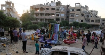 Children play at the Eid theme park as they celebrate Eid-al-Fitr, which marks the end of Ramadam, in beseiged East Ghouta, rural Damascus, Syria in June 2017.