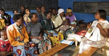 A UNICEF-supported female discussion leader facilitates dialogue about important social issues including health, hygiene, sanitation and HIV at a church in the village of Rwaza in the Musanze district of northern Rwanda.