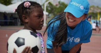 On September 14, 2019 in the Bahamas, UNICEF Emergency Response Team member Lisa Deters plays with children evacuated in the aftermath of Hurricane Dorian.