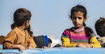 Families continue to flee escalating violence in northeast Syria in October 2019.