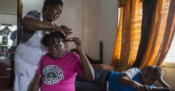 Corine Gerald and her children Jerrene, 11, and James Jr., 13, in their rental house in Antigua in November 2019. The family was displaced from their home in Barbuda by Hurricane Irma in 2017.