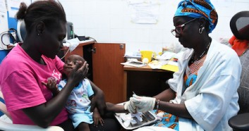 A baby is tested for HIV at a UNICEF-supported hospital in Côte d'Ivoire.