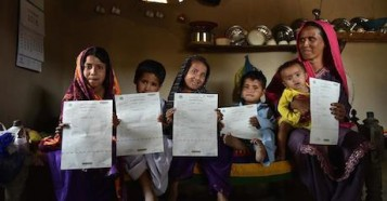 A mother and five children who were registered using a new digital service in Pakistan.