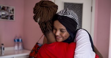 UNICEF Ambassador Halima Aden hugs a young asylum seeker at a UNICEF-supported reception center in Palermo, Italy on August 7, 2019.