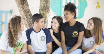 Letícia Gomes (far left), a 15-year-old girl from a small community in northeast Brazil, speaks with a group of teenagers as part of her peer-to-peer education work through UNICEF Brazil's Selo program.
