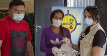 o help families in Venezuela struggling during the COVID-19 pandemic, UNICEF staffers like Maura De Moya (far right) work with partners to provide food kits and academic follow-up for students as part of the Education Cannot Wait program.