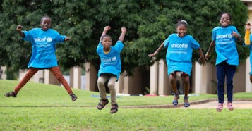 Koumba, Jean Uriel, Mariam and Yasmine jump for joy before World Children's Day 2020 in Abidjan, Côte d'Ivoire.
