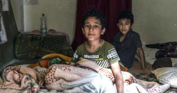 Brothers Ahmad (left), 10, and Abdullah, 9, and their family, refugees from Syria, are facing another frigid winter in Jordan. UNICEF emergency cash assistance and winter clothing kits will help them survive.