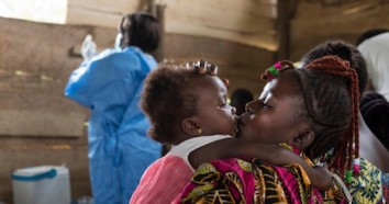 A mother kisses her daughter at a regularly scheduled, UNICEF-supported immunization clinic in the village of Kuka on the outskirts of Beni in North Kivu province, Democratic Republic of the Congo on 21 October 2019.