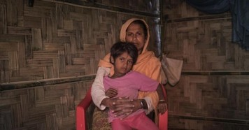 Anjuma Bengum holds her 5-year-old daughter, Lala Bibi, tight at their home in Balukhali refugee camp in Cox's Bazar Bangladesh on December 2, 2019. Anjuma's older daughter, 9-year-old Asma, disappeared en route to the market to buy groceries.