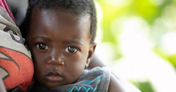 Clinton, 8 months old, of Tusenke, Gwenbe district, Zambia. Clinton's mother and grandmother receive support through a UNICEF emergency cash transfer program.