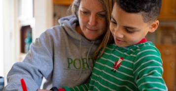 On the morning of March 16, 2020, 8-year-old second grader Luka works on a math assignment at home in Connecticut, with help from his mother, Sophia.