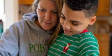 8-year-old second grader Luka works on a mathematics assignment at home in Connecticut, United States of America, with help from his mother, Sophia. Local schools were closed indefinitely effective the Friday before, 13 March, as part of precautions to co