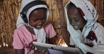 Children use their tablet and work with each other at the UNICEF supported Debate e-Learning Center in a village on the outskirts of Kassala, the capital of the state of Kassala in Eastern Sudan.