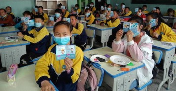 Students in China returned to school armed with health education leaflets provided by UNICEF to reinforce best practices to prevent the spread of COVID-19.