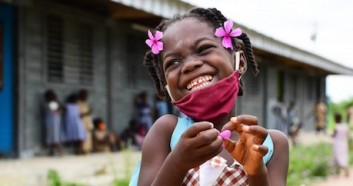A very happy girl at the playground outside of her school in Toumodi-Sakassou, in the center of Côte d'Ivoire.