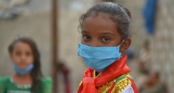 In Yemen, 7-year-old Jabra wears a mask to prevent transmission of the novel coronavirus.
