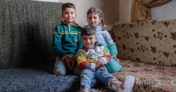 Siblings Anwar, 9, Nada, 6, and Mohammad, 3, are growing up in war-torn Syria. A UNICEF-supported cash transfer program helps their family pay for winter clothes and other necessities.