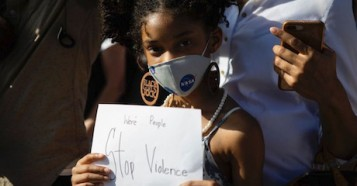 his young girl from Coral Gables, Florida, is one of many children who turned out to protest the death of George Floyd, an unarmed Black man who died while being arrested and pinned to the ground by a Minneapolis police officer on May 25, 2020. © Photo by