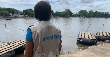 UNICEF staffer stands by the Suchiate River at the Mexico-Guatemala border — a popular crossing point along the migration route.