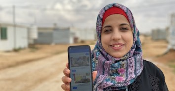 At a youth center in Azraq refugee camp in Jordan, home to more than 37,000 Syrian refugees, 19-year-old Amani accesses remote learning resources via the Learning Passport mobile app on a smart phone she received from UNICEF.