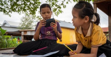 When their school was closed to prevent the spread of COVID-19, Kvas Em and Rocham Yhang kept learning via UNICEF-supported radio lessons in Paor Kekchong village, Borkeo District, Rattanakiri, Cambodia.