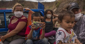 Thousands of people migrating from Honduras formed a caravan heading north in mid-January 2021.