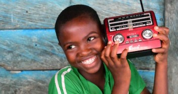 Keren, a 12-year-old girl, is listening to a radio education program, in the community of Idinau, in southwest Cameroon.