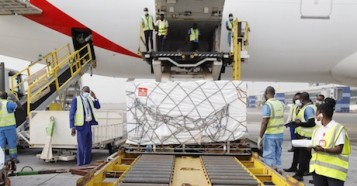 On February 24, 2021, staff unloads the first shipment of COVID-19 vaccines distributed by the COVAX Facility at the Kotoka International Airport in Accra, Ghana's capital.