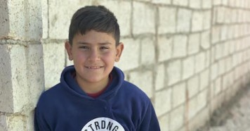 "Ten-year-old Ali is a Syrian refugee living in Mafraq, Jordan with his four brothers, two sisters and parents. His grandparents still live in Syria. ""I miss them and really want to meet them,"" he said."