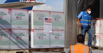 Vaccines are loaded into refrigerated trucks after 1.5 million doses of COVID-19 vaccines donated by United States Government via COVAX's dose-sharing mechanism arrived at Armando Escalón Espinal Air Base, San Pedro Sula Airport, Honduras on June 27, 2021