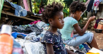 On August 18, 2021, 7-year-old Farah eats a meal at a temporary shelter in Marceline, Haiti. Farah and his family spent two hours trapped under the rubble of their house after it was destroyed by the 7.2 magnitude earthquake that hit Haiti on August 14, 2