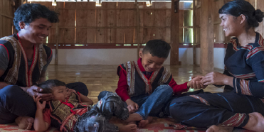 On 25 February 2020, Xu, 27, and his wife Del, 25, play with their two sons, Khon, 1, and Muih, 7, inside their home in Gia Lai, in the Central Highlands region of Viet Nam.