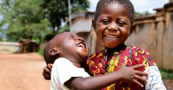 Two friends share a laugh in Korhogo, in northern Côte d'Ivoire in 2020.
