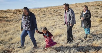 Three generations of a family, citizens of the Navajo Nation, photographed in Chinle, Arizona.