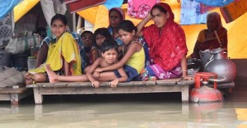Villagers take shelter in a flooded area of Morigaon district, Assam State, India.