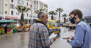 In Mhamdia, in the suburbs of Tunis, Tunisia, a group of UNICEF-trained Scouts talk to pedestrians about the risks of COVID-19 and share information about how to prevent infection.