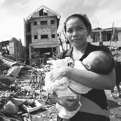 Filipino Mother and her child after Typhoon Haiyan