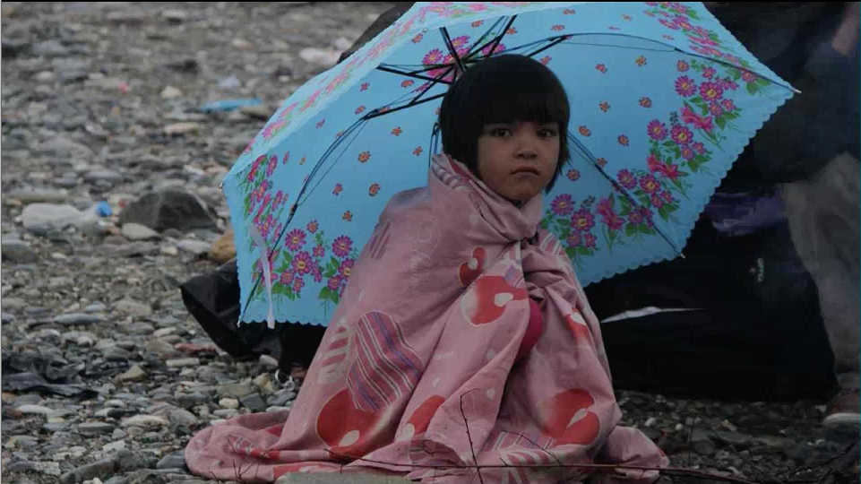 A girl stuck at the Greek border after escaping her homeland via the Balkan Route.