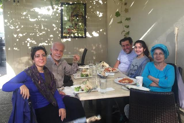 Narges Asad with her family.
